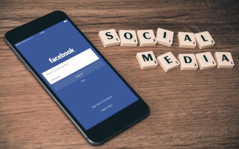 Social media scrabble tiles with smartphone